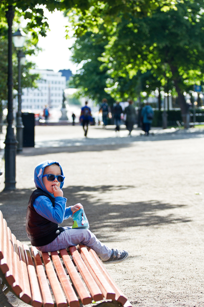 Toddler stopping for a snack in Helsinki, Finland