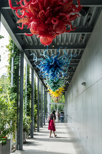 woman walking through Chihuly gallery